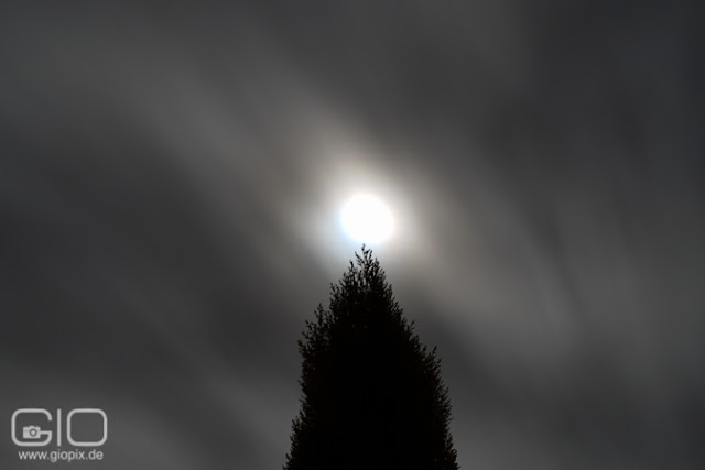 Long exposure with full moon and clouds