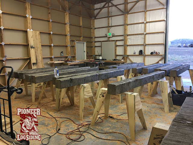 stained-solid-stained-beam-posts-drying-on-sawhorses