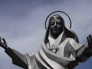 Immaculate Heart of Mary stainless steel sculpture at Trinity Heights in Sioux City