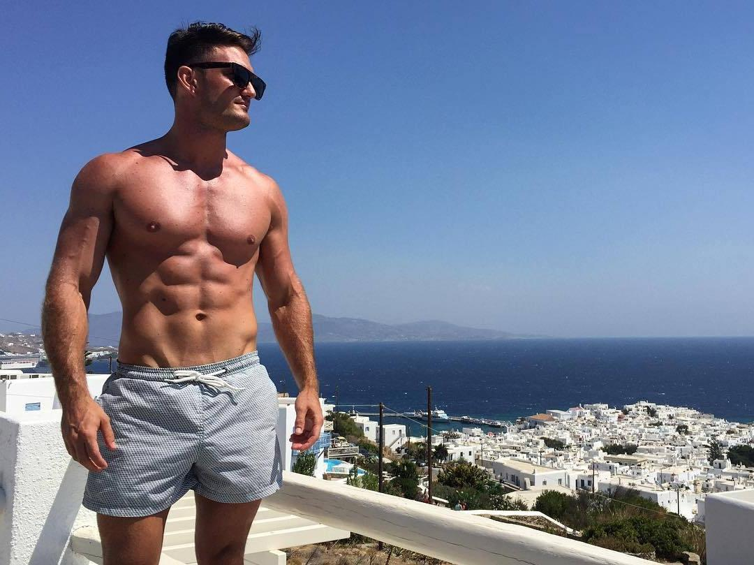 cool-fit-shirtless-male-model-sunglasses-greece-vacation-sunny-body