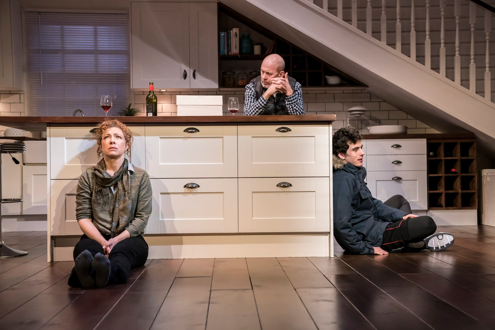 Alex Kingston, Andrew Woodall and Ben Edelman sit in the kitchen set for Admissions