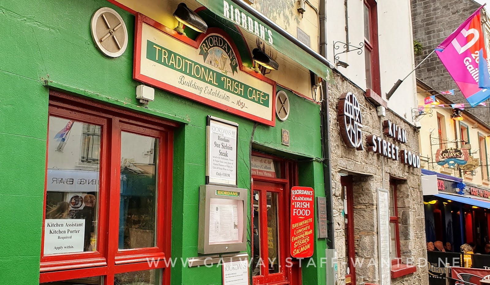 Green shopfront with red windows - sign traditional Irish food - evening means steaks - salmon- best bacon and cabbage in Galway city centre - irish stew - ham and turkey - chicken maryland
