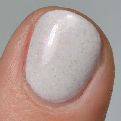 white nail polish with pink shimmer swatch