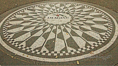 "This is a photograph of the ""imagine"" circle in Central Park. The #CentralParkConservatory describes it as ""an elaborate mosaic bearing the word 'Imagine'—a nod to the songwriter's anthem of peace—the memorial is surrounded by benches and shaded by stately American elms, making it a tranquil spot for reflection."" I included this image in an article about John Lennon that was published by iLovetheupperwestside @ https://bit.ly/3iSN9MC"