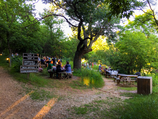 picnic areas are tucked into the wooded hillside along the path to the theater