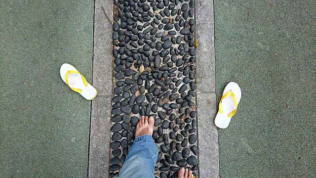 Acupressure on a stone path in a park, Reflexology