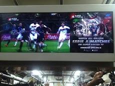 Menonton Cuplikan Gol-Gol Indah di Langit-Langit KRL Jabodetabek