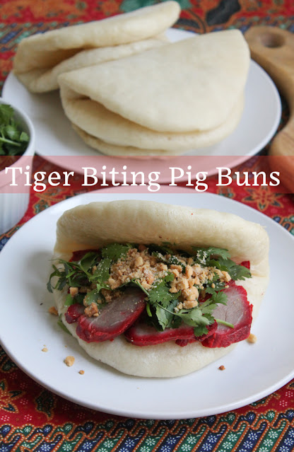 Food Lust People Love: Tiger Biting Pig Buns are soft, steamed bread filled with slices of rich char siu pork, fresh cilantro and roasted peanuts with a little sugar. Each bite is more delectable than the next!