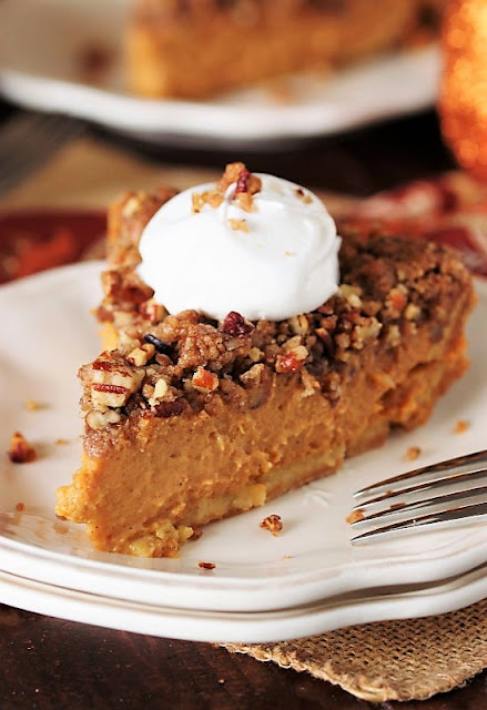 Piece of Pecan Streusel Pumpkin Pie with Whipped Cream Image