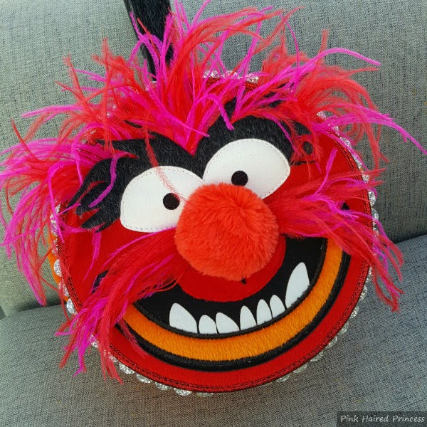 front of Muppets Animal face round handbag with feathers and faux fur