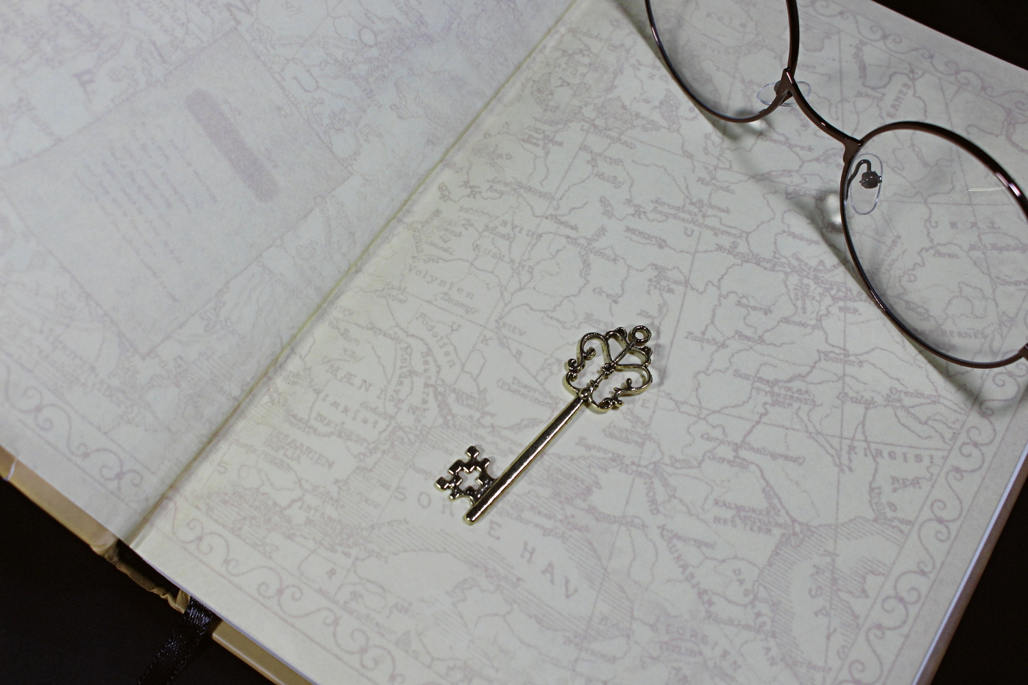 ba close up picture of a key pendant laying on an opened book