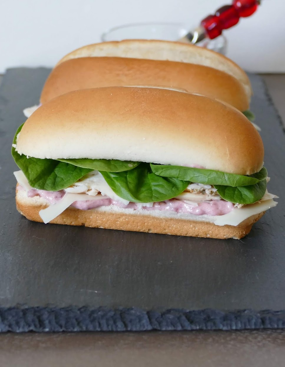 Use your leftover Thanksgiving or Christmas turkey, or deli turkey in this delicious sandwich! It's simple to make and tastes great with the cranberry mayo, spinach, turkey and swiss cheese! Make it for lunch or serve at your next game day party.