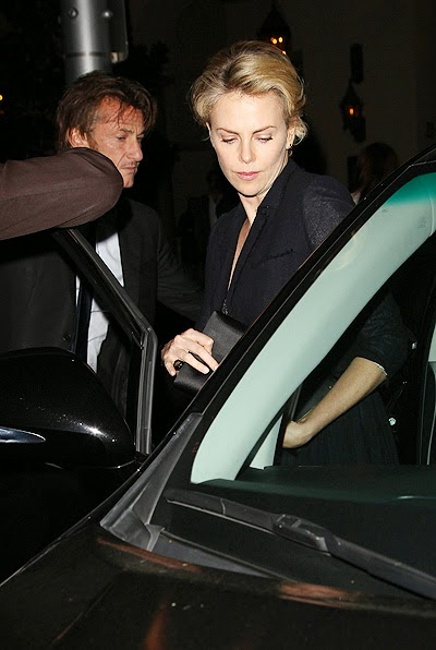Charlize Theron and Sean Penn at a charity dinner