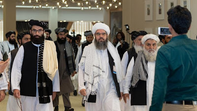 Taliban say team in Qatar for Afghan peace talks