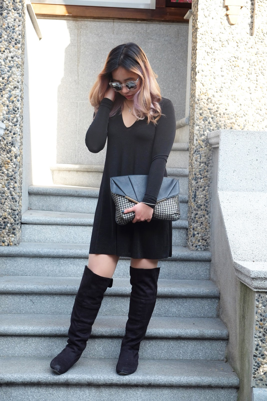 This is a photo of pairing overknee boots with dress by Sidney Scarlett from www.sidneyscarlett.com