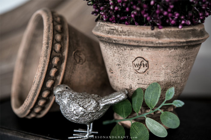 Silver bird and clay pots