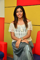 Eesha in a cute deep neck top and Skirt at at Big FM 017.JPG