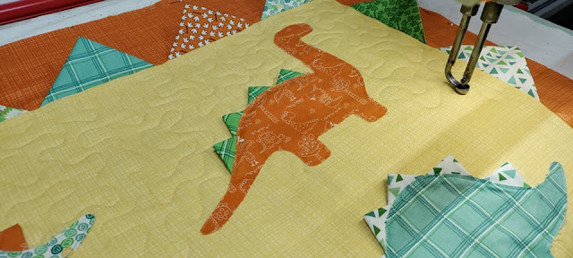 Meander quilting on a dinosaur quilt