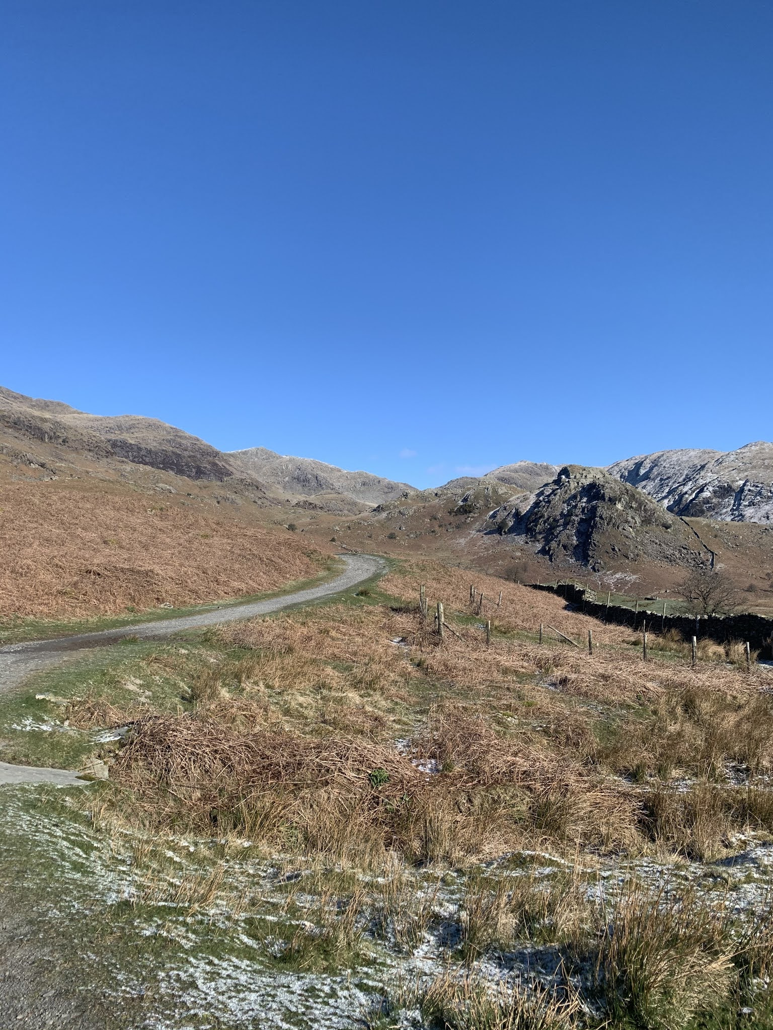 the gravel path at the beginning of the old man of coniston hike in the lake district