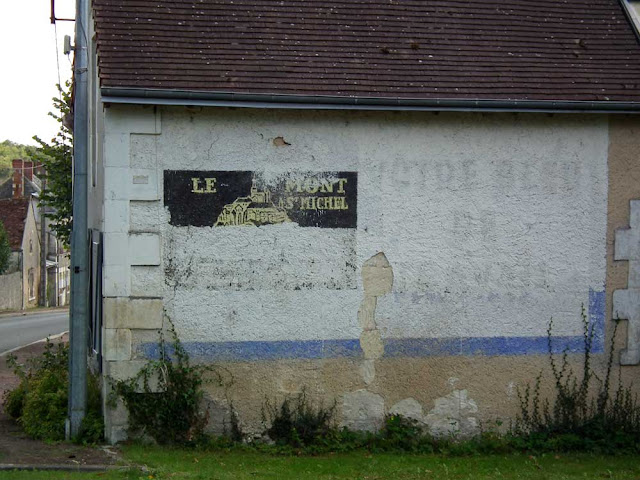 Mont Saint Michel workwear (bleu de travail) ghost sign.  Indre et Loire, France. Photographed by Susan Walter. Tour the Loire Valley with a classic car and a private guide.