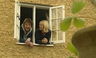 Ann-Marie and Dilys look out the window