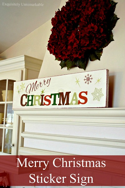 using a sticker to make a wooden christmas sign