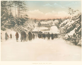 A group of people on a ski hill.