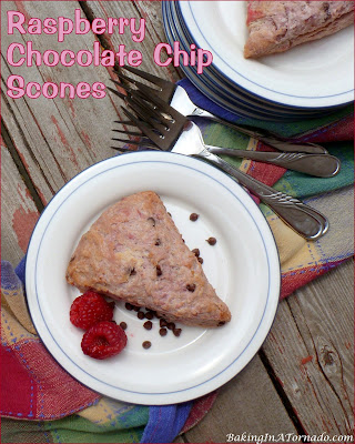 Raspberry Chocolate Chip Scones. Fresh raspberries are infused into a scone studded with mini chocolate chips. | recipe developed by www.BakingInATornado.com | #recipe #breakfast