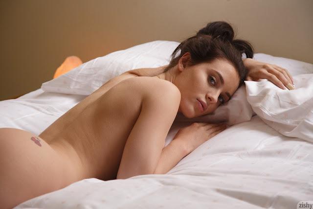 Lana Rhoades lying naked on bed