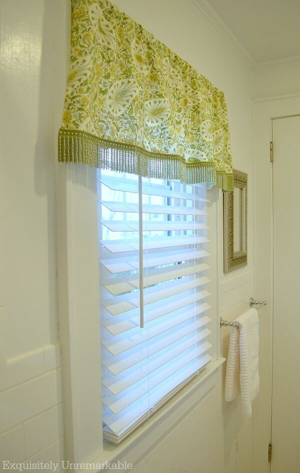 White Wooden Blinds In The Bathroom