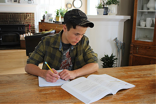 Teen doing homework for homeschool