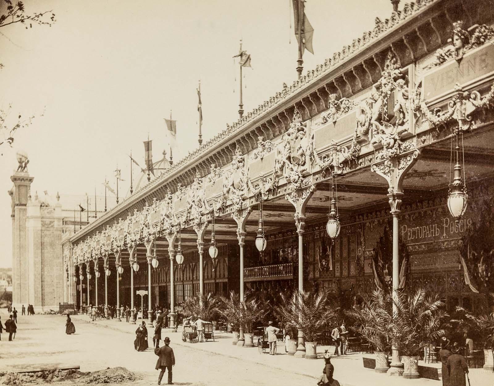 Visitors strolling between exhibitions.