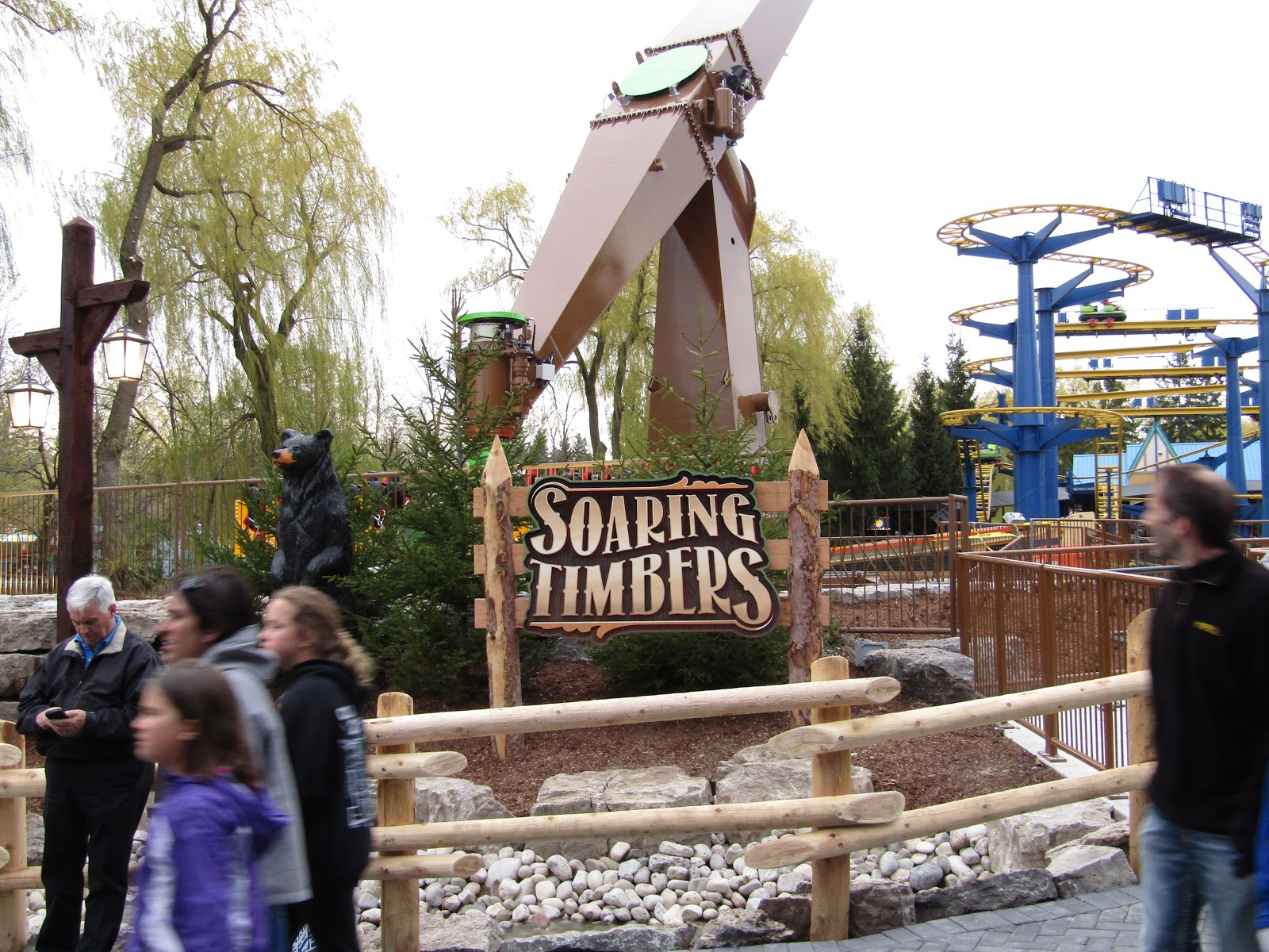 The Soaring Timbers sign supported by cedar posts. The sign is light brown in colour.