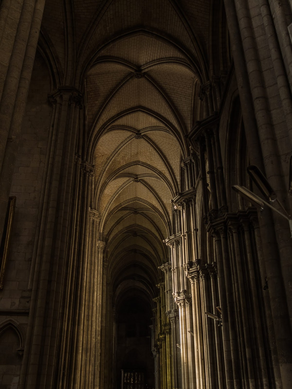 Side aisle inside the Cathedral of Notre Damme in Rouen, France.