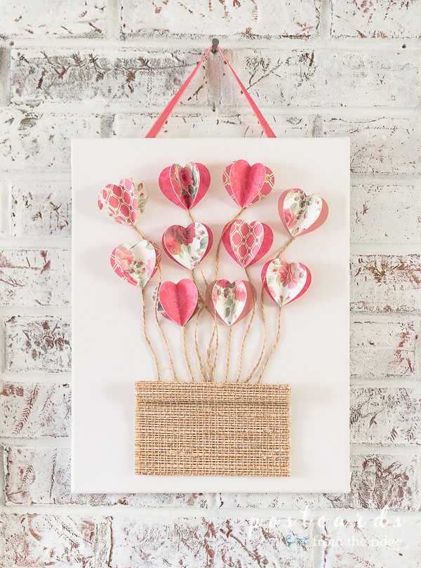 white canvas with 3-D paper hearts and twin with woven wood piece