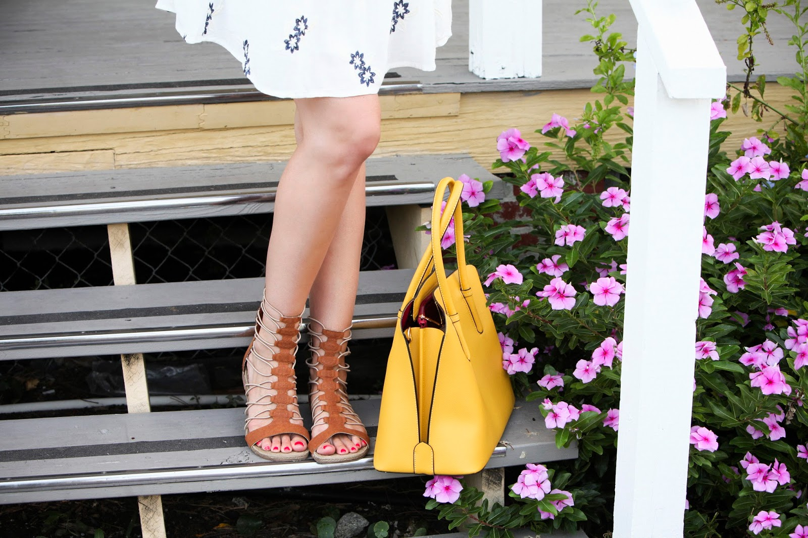 gladiator sandals and yellow handbag