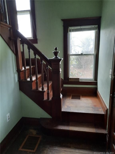 entry hall staircase color photo with original woodwork 44 Colchester Ave East Hampton CT Sears Avoca Sears 109