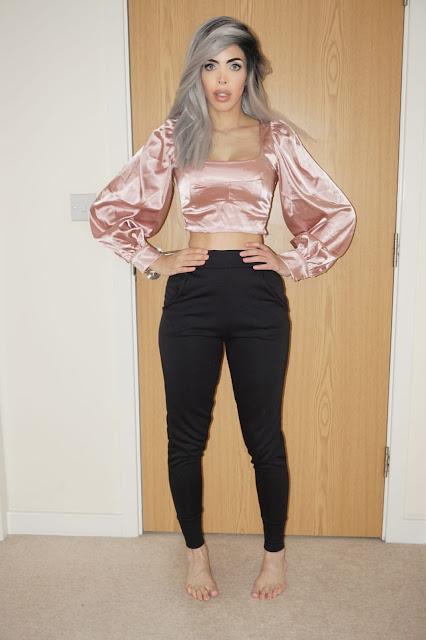 Femme Luxe Black Cuffed Pocket Detail Joggers in model Teddy.
