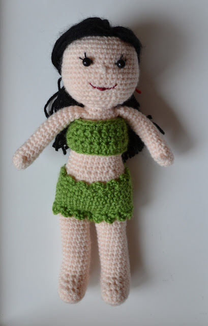 "Kwokkie Doll modelling the green ""Bondi Bikini"" - a bandeau style top with a full brief bottom. The top and the legs of the bottom are trimmed with a little ruffle."