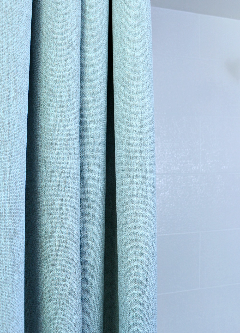 Ceiling Mounted Shower Curtain Rod + Turquoise Tweed Pleated Shower Curtain  In Modern Bathroom Reno |
