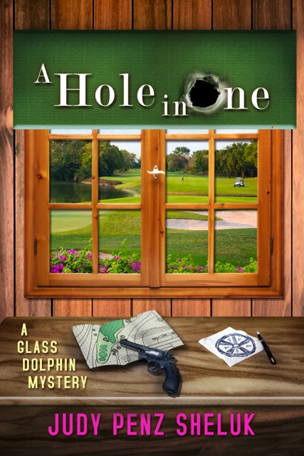 A Hole in One (A Glass Dolphin Mystery Book 2) by Judy Penz Sheluk