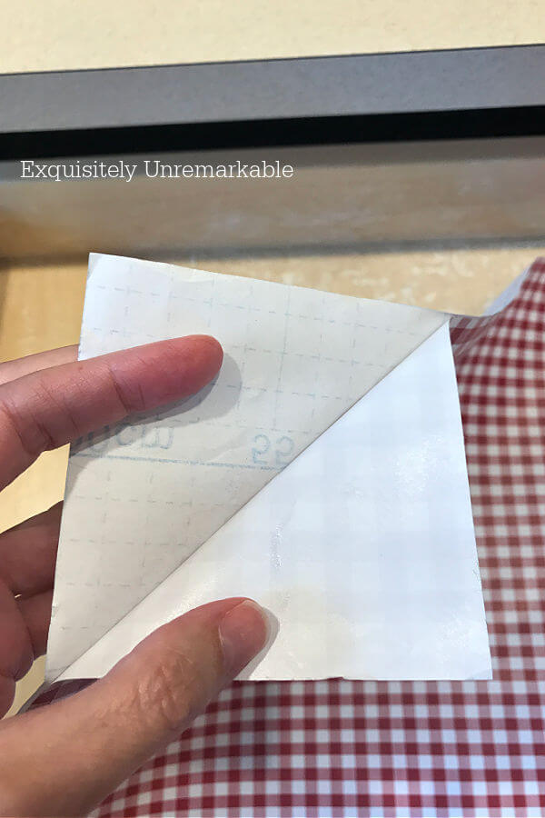 Peeling Backing From the corner of Contact Paper