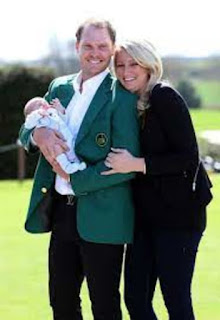 Danny Willet And His Wife Holding Their First Child In