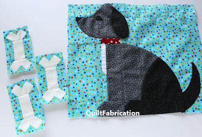 black dog quilt block with 3 dog bone blocks