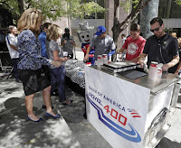 Kurt Busch and Christopher Bell served Rocky ROVAL™ ice cream to fans at a Bank of America ROVAL™ 400 pep rally on Tuesday in Uptown Charlotte.