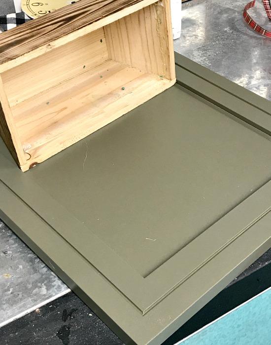 green cabinet door with wooden basket