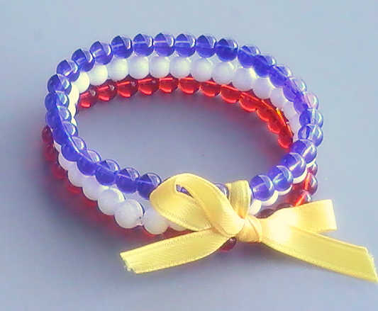Patriotic Bracelet Trio 10 Smooth Round Gl Beads In Royal Blue Red And White Are Stacked Together Joined By A Simple Yellow Ribbon