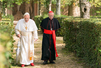 "Anthony Hopkins and Jonathan Pryce star as Pope Benedict XVI and Pope Francis in Netflix's ""The Two Popes"" (2019)."