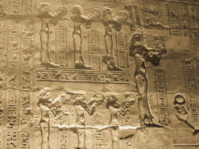 The Seven Hathors playing on the tambourine. Temple of Horus at Edfu.