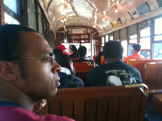 Man takes a ride on the New Orleans Streetcar (interior)